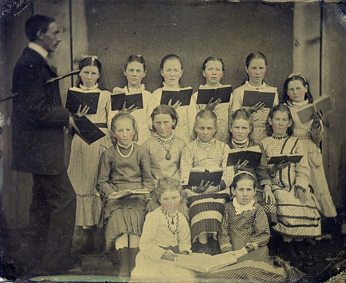 Choir of girls with their conductor.